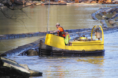 fraser river: A boom operator sorts cedar logs on the Fraser River on British Columbias west coast near Matsqui on March 30, 2016.