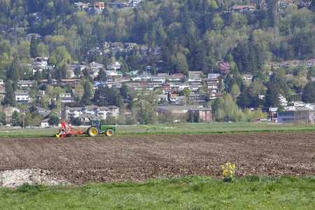 encroaching: An ever encroaching city squeezes out farmland.