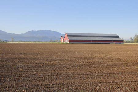 agronomic: Spring in rural Canada where the farm land is readied for planting.