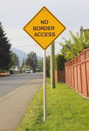 A sign clearly states there is no access to the border on this particular road. Stock Photo
