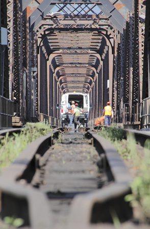 maintaining: Vertical view of crews maintaining and repairing train track