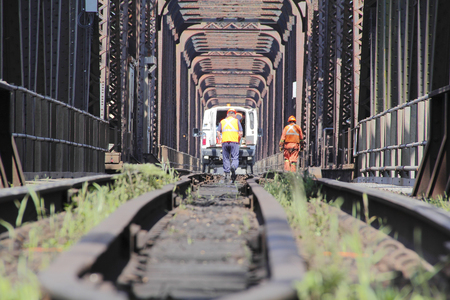 Crews regularly inspect aging train track to maintain safety. 版權商用圖片