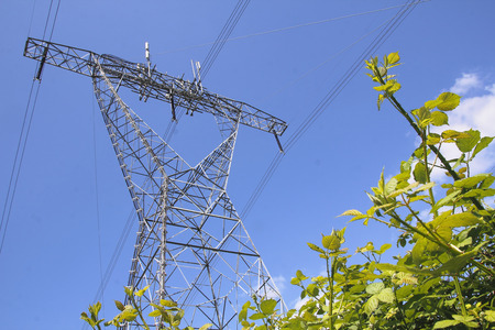 Telecommunication antenna are mounted high above on hydro electric towers. Stock fotó