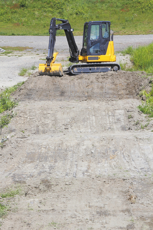 maneuvering: An industrial excavator capable of maneuvering in and around narrow areas.