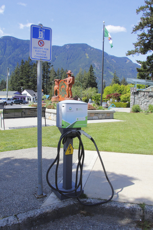 parking facilities: An electric vehicle charging station spotted in Hope, British Columbia, Canada on April 30, 2016. Editorial