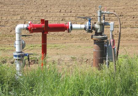 acreage: A small gas collection pipeline on a rural farm acreage.