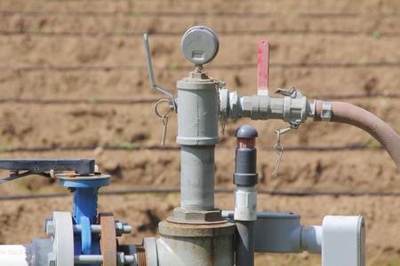 acreage: Close on a small gas collection pipeline on a rural farm acreage. Stock Photo