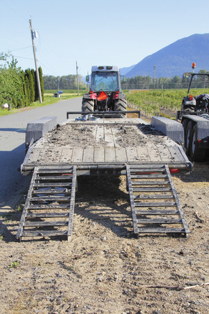 hauling: Rear View of a Flatbed platform used for carrying heavy industrial equipment.