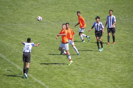 west  coast: Teenage boys of various ethnicity play soccer on Canadas west coast on May 6, 2016.
