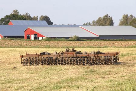 A disc harrow used for tilling the soil. Stok Fotoğraf