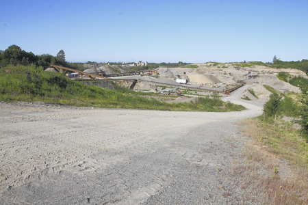 gravel pit: Acres of land have been carved up by a huge gravel pit.