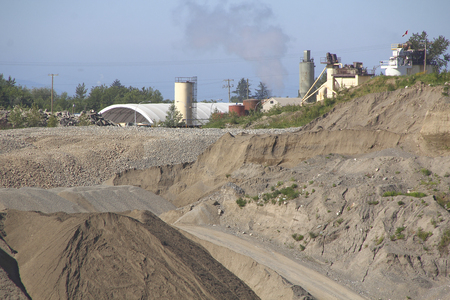 mined: Close on an open quarry where gravel is mined.