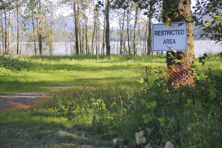 posted: A sign is posted stating that the area is restricted. Stock Photo