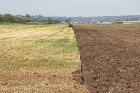 acreage: A well defined acreage that is halfway plowed.