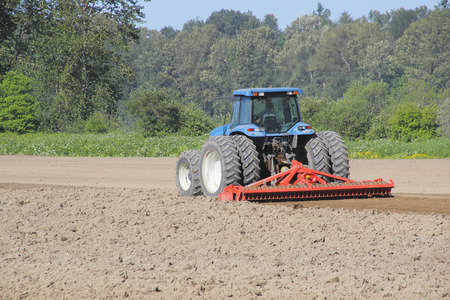 flattened: Soil is flattened, graded, and prepared for planting corn.