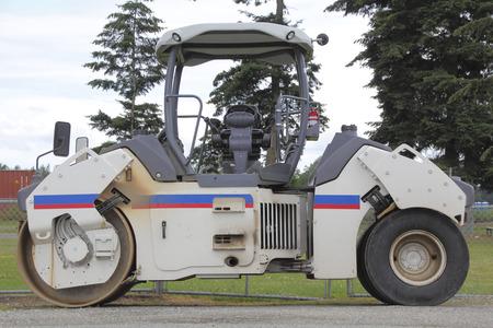 An industrial roller will be used to flatten asphalt when it is applied. Stock fotó