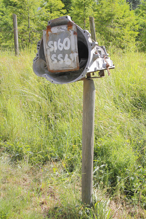 car transmission: A car transmission has been altered and made into a mailbox.