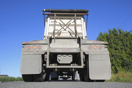 low angle: Low angle view of the back of a dump truck. Stock Photo
