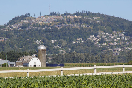 City development is beginning to encroach on farm land. Stock Photo