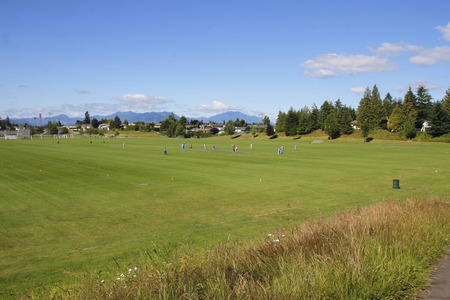 recreational sports: Teams and recreational sports is played on a large city sports field. Stock Photo