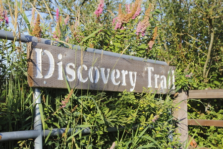 wooden trail sign: A sign marks where Canadas Discovery Trail continues. Stock Photo