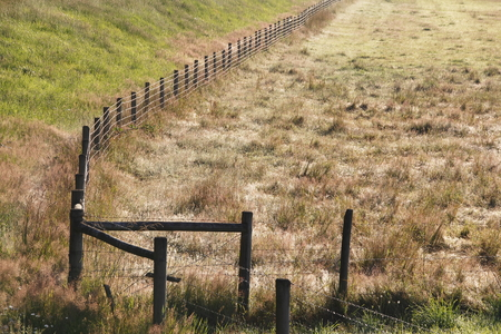 acreage: A fence separates public and private lands.