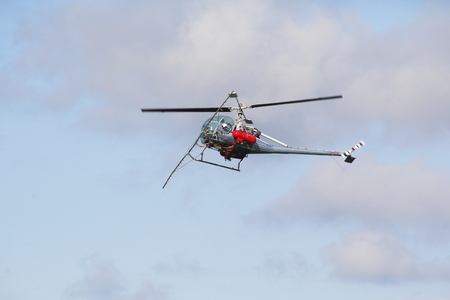 dusting: The underside view of a helicopter used for crop dusting in Sumas, Washington. Editorial