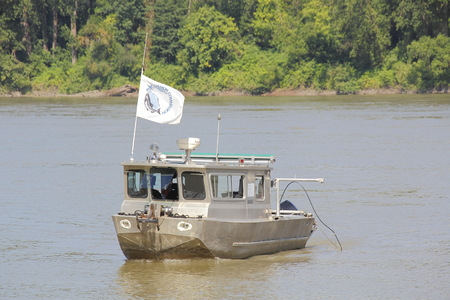 fraser river: A Salmon Commission boat, expecting a low salmon run, probes the Fraser River near Mission, BC, Canada on July 16, 2016. Stock Photo