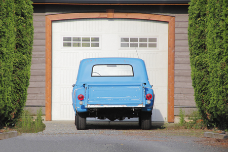 restored: An old light blue American truck sits proudly restored in the owners driveway.