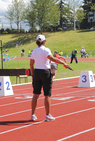 A starters pistol or gun is used during track and field competition.
