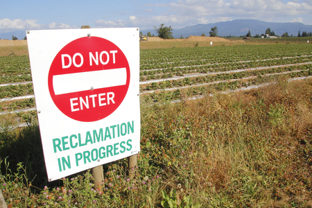 temporarily: Land, used temporarily for mining, has been restored to agricultural use.
