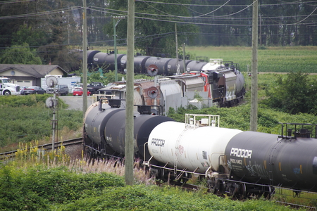 goods train: Dangerous goods, including gas, oil and chemicals are transported by train near Mission, BC on July 30, 2016.