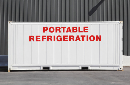 versatile: Close on a large industrial sized metal container that provides portable refrigeration.