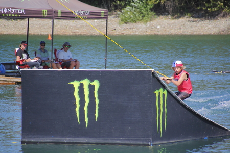 off ramp: A competitor launches off a ramp while judges watch during  Wakeboard competitions at Albert Dyck Lake near Abbotsford, BC, Canada on August 6, 2016.