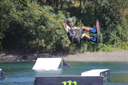 off ramp: A competitor launches off a ramp during  Wakeboard competitions at Albert Dyck Lake near Abbotsford, BC, Canada on August 6, 2016. Editorial
