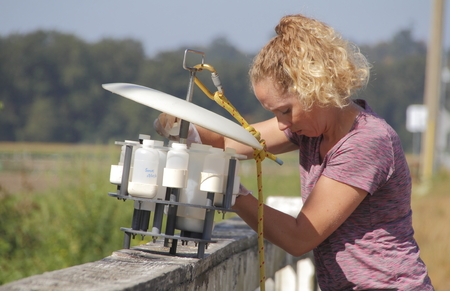 A biologist with Environment Canada prepares to lower equipment used to test oxygen levels in water in a local creek near Huntington, BC, Canada on August 16, 2016.