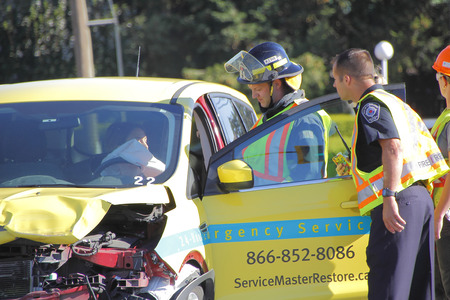 front end: A serious two car collision at the intersection of George Ferguson Way and Trethewey is attended to by Fire Services on August 19, 2016 in Abbotsford, BC, Canada. Editorial