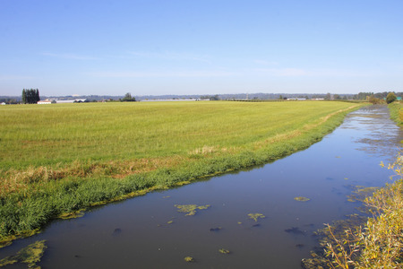 Despite severe summer drought conditions, man made canals provide fresh water for agricultural needs.
