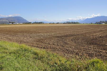 seeding: The land has been plowed and ready for seeding in a Canadian agricultural farm. Stock Photo