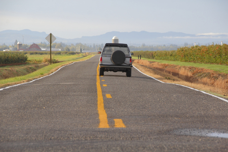 solid state drive: Solid and short lines for passing rules on a rural road in Washington State. Editorial