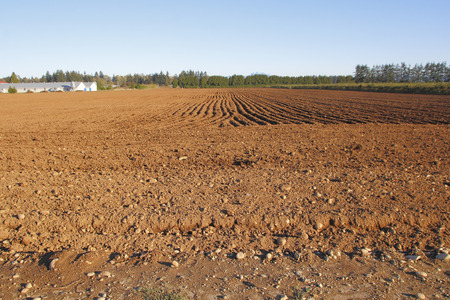 Farm land has been turned over and cultivated in preparation for seeding. Stock Photo