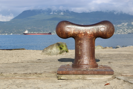 A bollard is a short vertical post used on a ship or a quay for mooring.