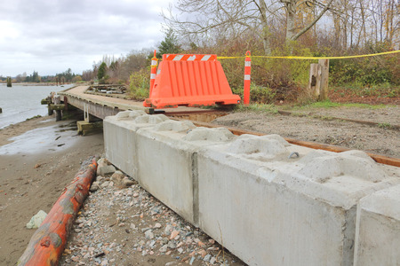 severe weather: A barrier is used to restrict access on a boardwalk that has been damaged by severe weather.