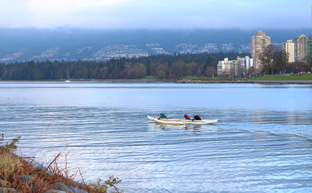 Seniors enjoy a morning of paddling on English Bay near Vancouver, Canada on November 28, 2016.