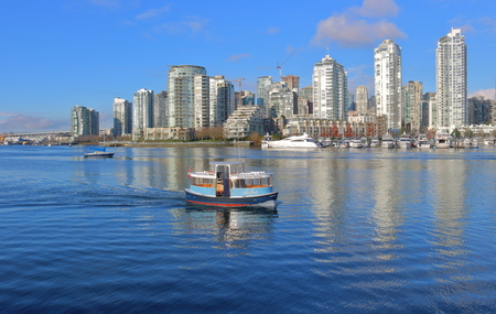 A small boat ferrying people across False Creek on November 28, 2016 is one of many various modes of public transit in Vancouver.