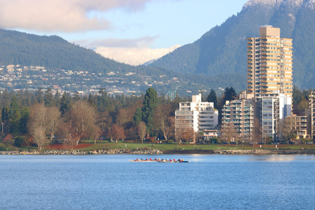 A group of people enjoy a morning rowing across English Bay near Vancouvers Westend and Stanley Park.