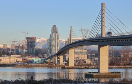 Vancouvers Skybridge and Skytrain as it crosses the Fraser River into Richmond.