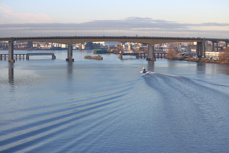 west river: Looking west across the south Fraser River and Vancouvers Oak Street Bridge. Stock Photo