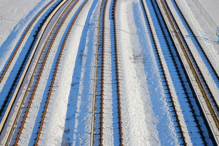 multiple: Multiple lanes of snow covered train tracks during the winter months.