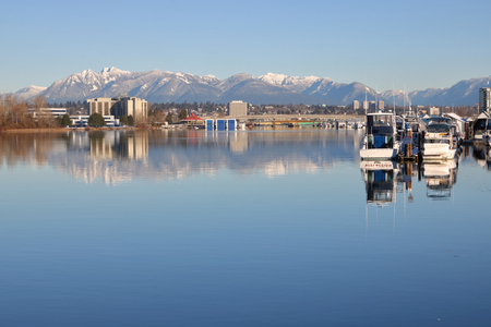 fraser river: Looking east from Richmond, BC to the Northshore Mountain range.